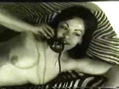 Nude vintage girl takes a phone call and smokes her cigarettes sensually
