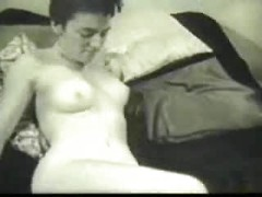 Slender solo milf with short hair relaxes with her tits and ass exposed