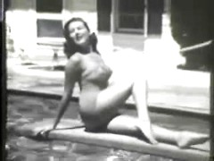 Sexy pin-up girl poses in her favorite new one piece swimsuits poolside