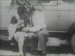 1920s couple parks their car and has vintage sex in the grass