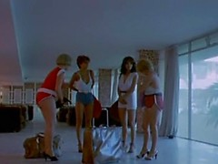 Four retro lesbians on vacation enjoy each other in a passionate scene