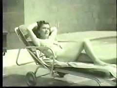 Busty vintage pinup girl goes skinny dipping and enjoys the warm sun