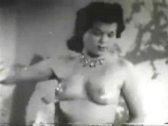 Vintage pinup oils her little tits and moves her hips in the most sensual way