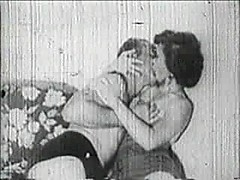 Erotic vintage porn shows the passion of a real couple as they kiss and she sucks cock