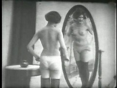 Vintage stockings and panties on two playful ladies in a stag film
