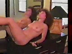 Retro curly hair wife with a shiny dildo vibrates her clit and toys her cunt